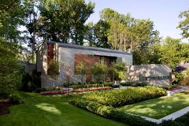 modern stone house with beautiful landscaping kojatillslott inspirig modern landscape of self sustaining home with beautiful green garden using colorful flowrs and plants mix to stone mosaic wall in unique self