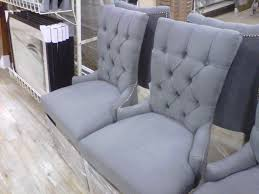 gray upholstered high back tufted dining room chairs with low arms