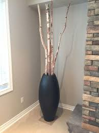 of 2 decorative urns with tall birch branches