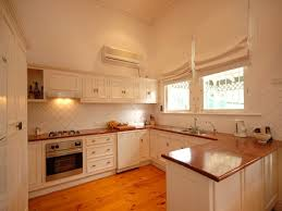 c kitchen ideas view of c shaped kitchen with window on far back wall and