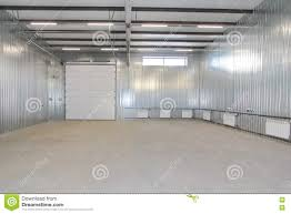 Warehouse Interior Empty Parking Garage Warehouse Interior With Large White Gates