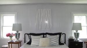 bedroom beadboard bedroom dark hardwood wall mirrors table lamps