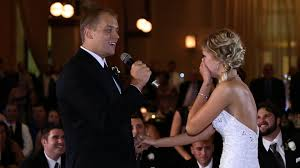 his and wedding groom surprises his by singing starting flash mob at their