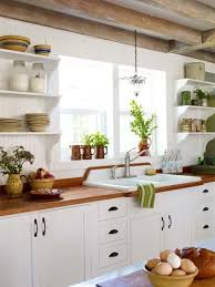 kitchen with white cabinets and wood countertops all about wood countertops home kitchens kitchen remodel