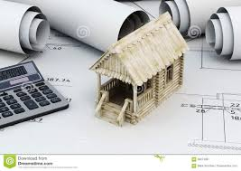 drawings for building and small wooden house with calculator stock