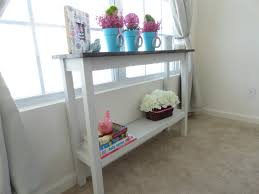 narrow hallway house design with small wood console table with