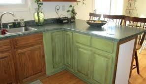 green kitchen cabinet ideas distressed green kitchen cabinets mountain retreat rustic kitchen