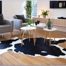faux cowhide rug rugs home decorating ideas wlrj5yjxry