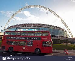 view of wembley stadium showing red double decker bus london