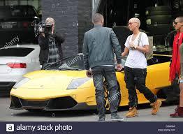 Amber Rose Looking At A Lamborghini Sports Car At Platinum Stock