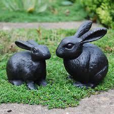 pair of black cast iron rabbit animal garden ornaments bunny or