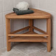 pie shaped corner teak corner shower caddy on grey tile bathroom