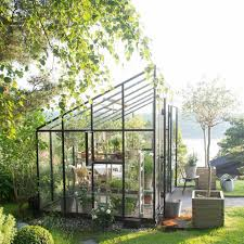 greenhouse sunroom eclectic landscape and yard with doors sunroom zillow