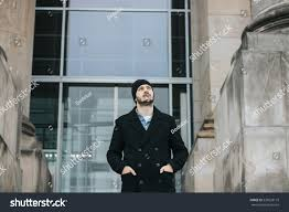 Looking Down Stairs by Young Hipster Man Walking Down Stairs Stock Photo 530528119
