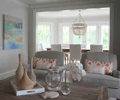 gray chairs with orange pillows transitional living room