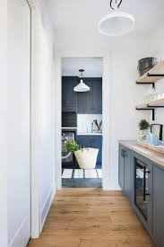 blue kitchen cabinets with wood countertops blue pantry cabinets with wooden countertop transitional
