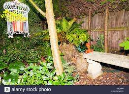 typical garden plants flowers seat with ornamental bird