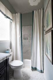 Bathrooms With Shower Curtains Drop In Shower With Two Shower Curtains Accented With Ribbon Trim