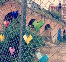 Decorate A Chain Link Fence Yarn Bombing Fence Yarn Bombing Yarns And Playground
