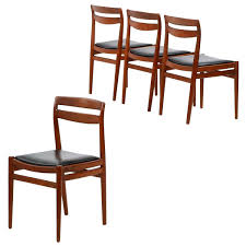 four danish mid century modern teakwood side chairs retailed by