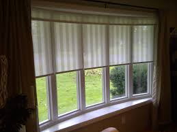 blinds for living room bay windows including how to dress window blinds for living room bay windows gallery also another bow window treatment the picture