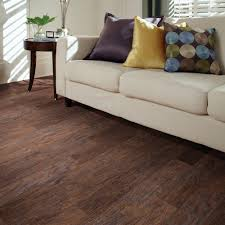 this hand scraped dark hickory laminate flooring has an embossed