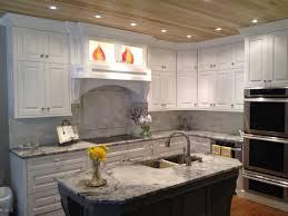 white fantasy granite white cabinets backsplash ideas