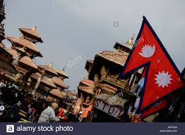 Pics Of Nepal Flag The Flag Of Nepal Backdropped By Temple Pagodas At Patan Durbar