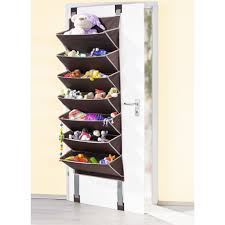 grey fabrick wall mounted shoe racks on white wooden door in