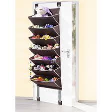grey fabrick wall mounted shoe racks on white wooden door in