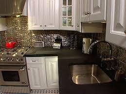 aluminum backsplash kitchen kitchen how to install ceiling tiles as a backsplash hgtv 14009419