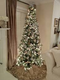 gorgeous slim tree with gold decorations the
