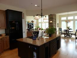 small sectional two toned cabinets in kitchen under green pattern