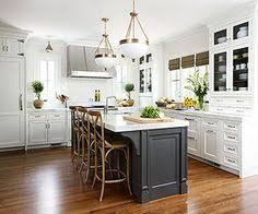 small white kitchen island consider painting your island a different color than your cabinetry