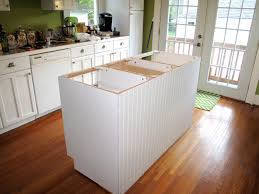 for the love of character kitchen island updated cabinets are in 1 one more coat of paint 2 paint mount the corbels support for the countertop 3 seam the edges and purchase base boards