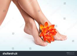 Leg Flower - beautiful womens legs fresh orange lotus stock photo 492511354