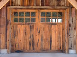 reclaimed wood garage doors add a vintage charm entry systems