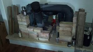 02 20 13 reginalds rocket stove fireplace update fire brick temps