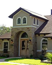 stone stucco tuscan mediterranean arch wood door tower