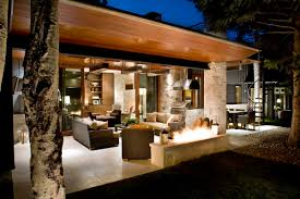 ranch home designs with stone pillars and stairs also
