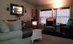 mobile home makeover view of front with lit harman pellet stove