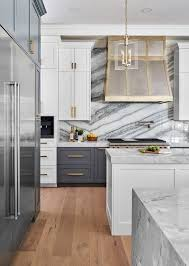 white kitchen cabinets with marble counters 25 timeless and chic marble kitchen backsplashes shelterness