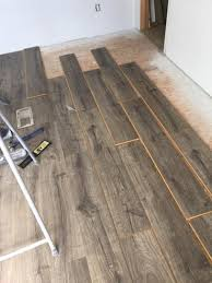 vintage pewter oak natural laminate floor with wear and spill