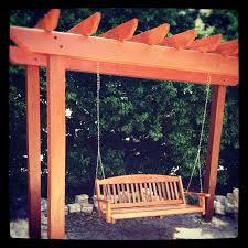 benefits pergola swing white garden landscape