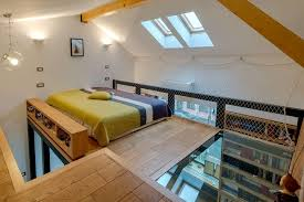 romanian loft renovation with a glass bedroom floor by in situ