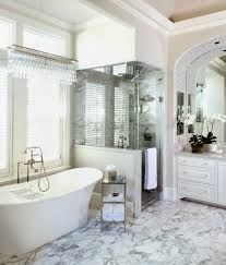 rectangle glass shower areas with towel hook and white bathtub