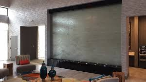 custom water wall indoor glass lobby waterfall holiday inn houston