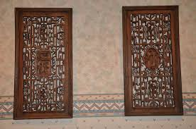 white wood carved wall into the glass different decoration