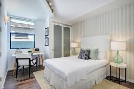 contemporary master bedroom with wall sconce by the noel team