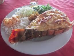 cuisine langouste plancha queue de langouste à la plancha flambée au rhum photo de cielo